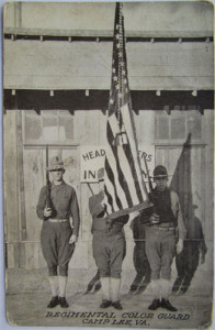 WWI Color Guard at an Army camp. America woul eventually enter the conflict