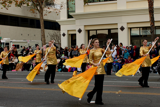 Davis HS Color Guard  From Kaysville, Utah waves colored flags as they march in the 2013 Rose Parade. Photo by Prayitno.