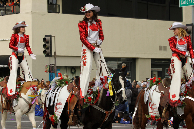 The Canadian Cowgirls sporting their Canada flag inspired costumes at the 2013 Rose Parade.  Photo by Prayitno