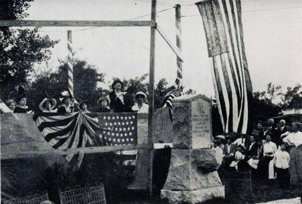 In 1912, DAR members raised flags.