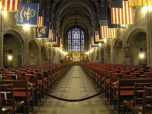 An array of flags hangs over West Point's chapel