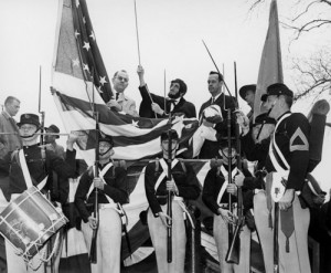 On the 100th anniversary, Kansans portray President Lincoln's 1861 hoisting of the 34-star flag in Philadelphia, Pennsylvania, when their state entered the U.S. (Photo from Kansas Memory)