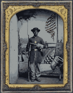 A Civil War soldier poses with a flag ca 1863. (Library of Congress)