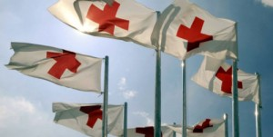 Red Cross flags fly.