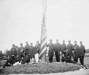 Troops lower American flag in Washington, D.C., during the War Between the States. (Library of Congress)