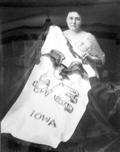 Dixie Gebhardt with Iowa's flag, which she created.