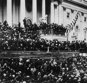 As a flag flaps, Lincoln delivers his second inaugural address in 1865. (Library of Congress)