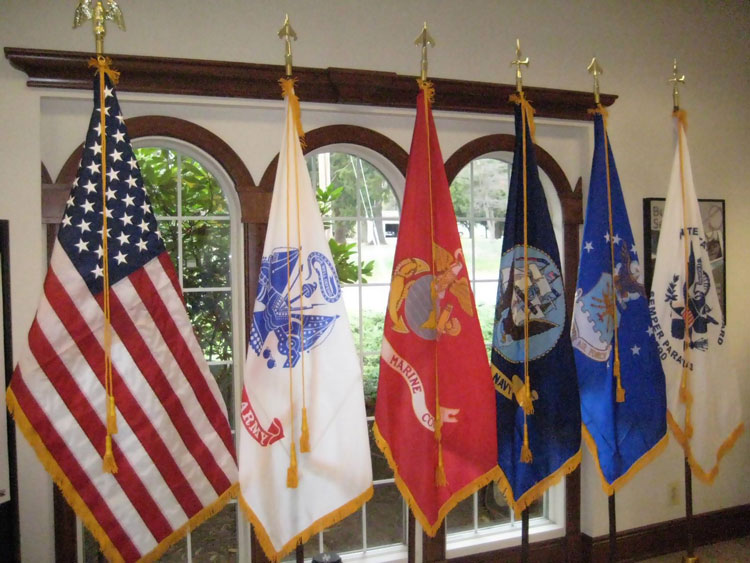 Correct order of precedence for American Flag and U.S. military service flags.