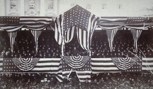 Grover Cleveland, from his reviewing stand, watches his 1885 inauguration parade. (Library of Congress)