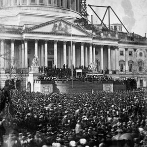 Lincoln's first inauguration with a flag flapping wildly in the wind. (wikipedia.org)