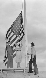 Rep. Nan Honeyman of Oregon lowers a flag at the Capitol in 1938. (Library of Congress)