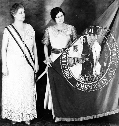 Two women admire the Nebraska flag in 1925. (nebraskahistory.org)