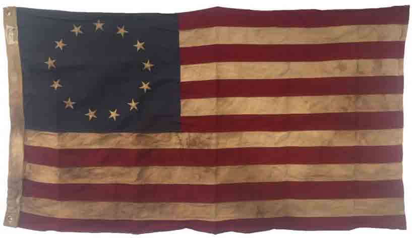 The Stars and Stripes, as designed by Betsy Ross, was hoisted on the sloop-of-war Ranger, making her the first American warship to carry the flag.