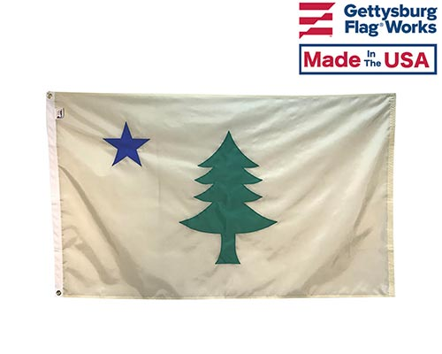 Original Maine State flag featuring a blue north star and a green pine tree on a beige background