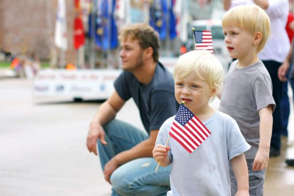 Children Holding American Flags at Parade