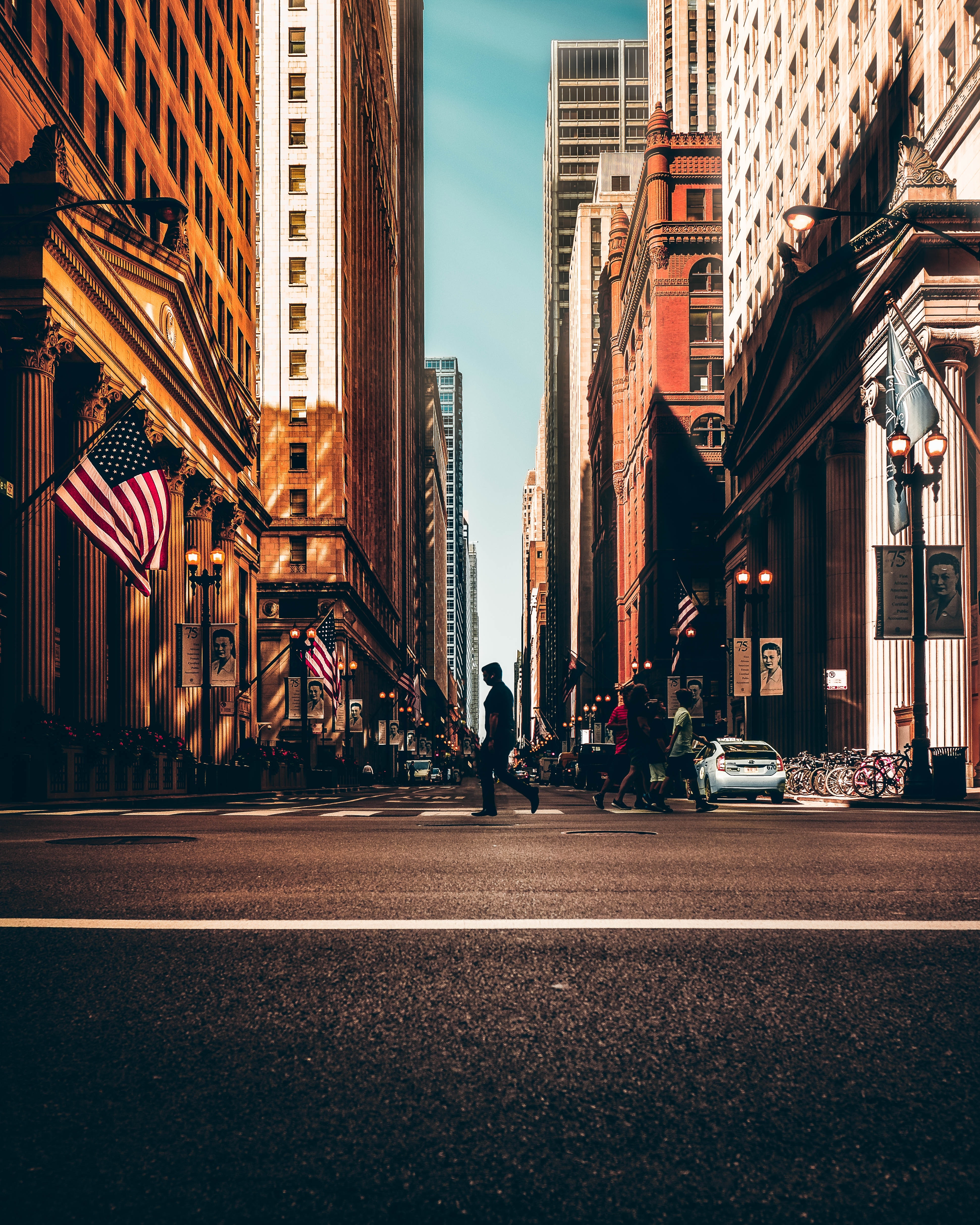 Empty city street with American Flag on Building