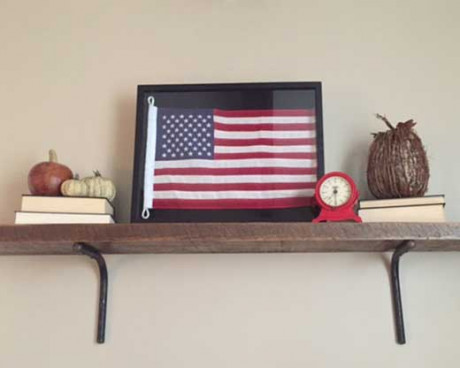 Framed American flag on shelf