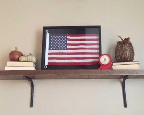 Framed American flag on shelf
