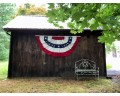 Patriotic Pleated Fan on Barn