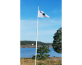 original maine flag on pole by water