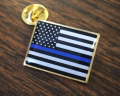Thin Blue Line Lapel Pin on Table
