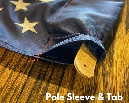 pole sleeve and tab attachment