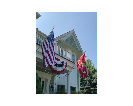 US Marine Corps flag and American Flag on house