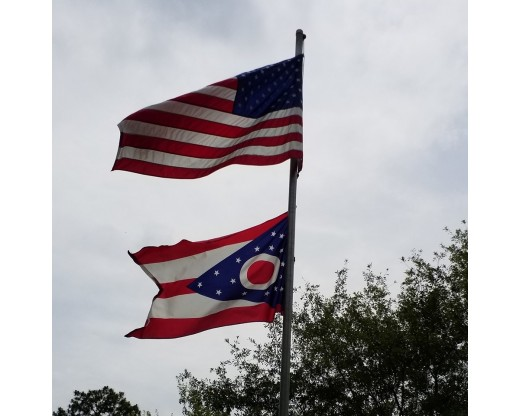 ohio state flag with american flag close up