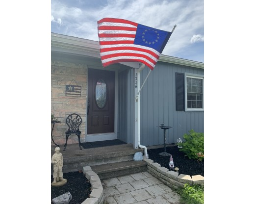 Betsy Ross flag on house pole
