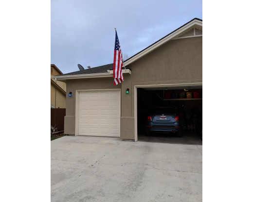 heavy duty american flag mounted on garage