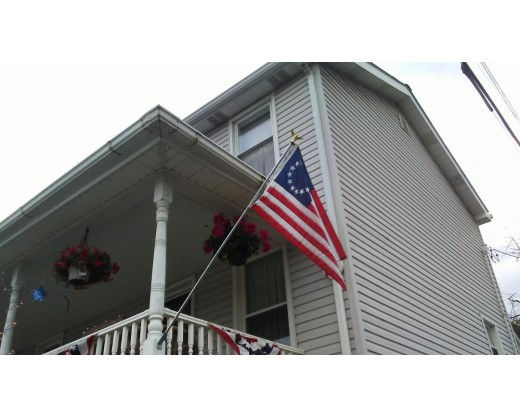 Betsy Ross flag on porch