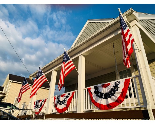 Pleated fans with flags on porch