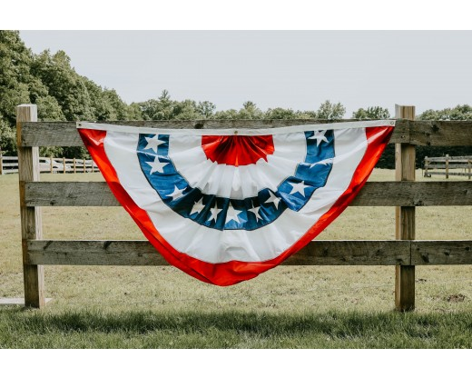 patriotic pleated fan on fence
