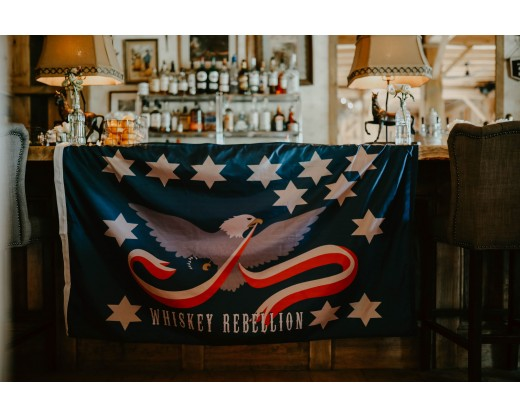 whiskey rebellion flag on bar close up