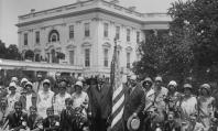 American flag flies on White House  in 1929 while President Hoover stands next to one to welcome teens. (Library of Congress)