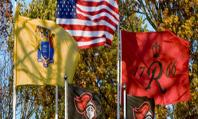 Rutgers' flag flies with American and New Jersey flags