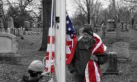 Mike Cronin holds the new American Flag while Sean raises it onto the new flagpole.