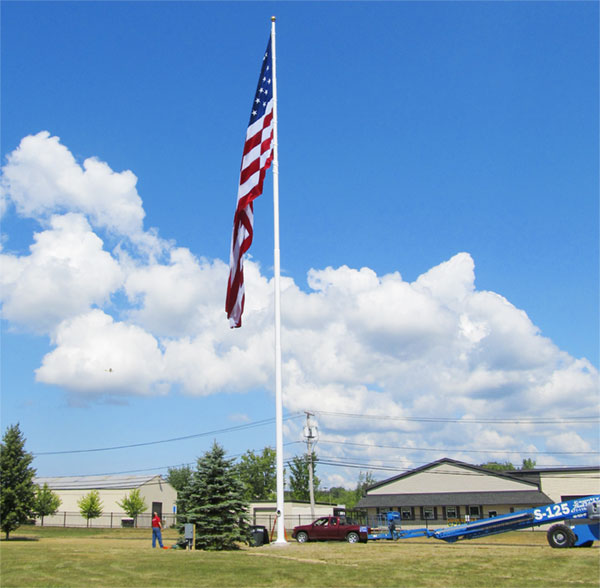 100' White steel flagpole installed at Trustco in Scotia, NY. This pole flies a 30x60' American Flag.